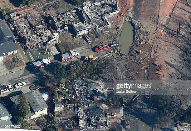 A section of pipe is seen near a massive crater at the scene of a gas main explosion September 10 2010 in San Bruno California Thirtyeight homes were...