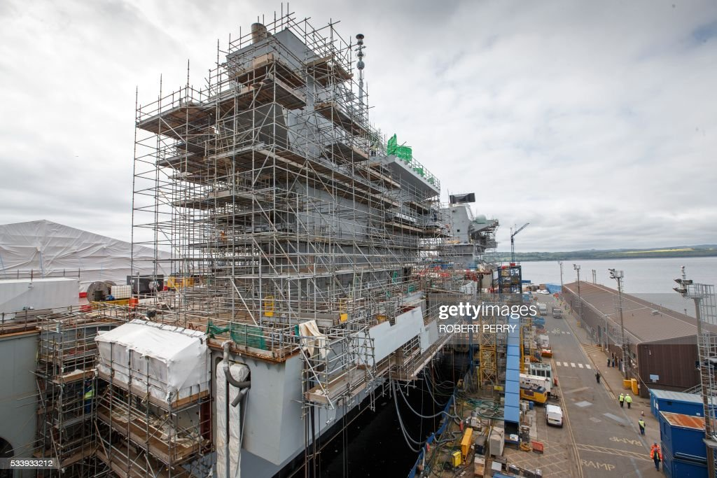 A section of the 65,000-tonne British aircraft carrier HMS Queen Elizabeth is pictured under construction in Rosyth dockyard in Scotland, on May 24, 2016. / AFP / Robert Perry