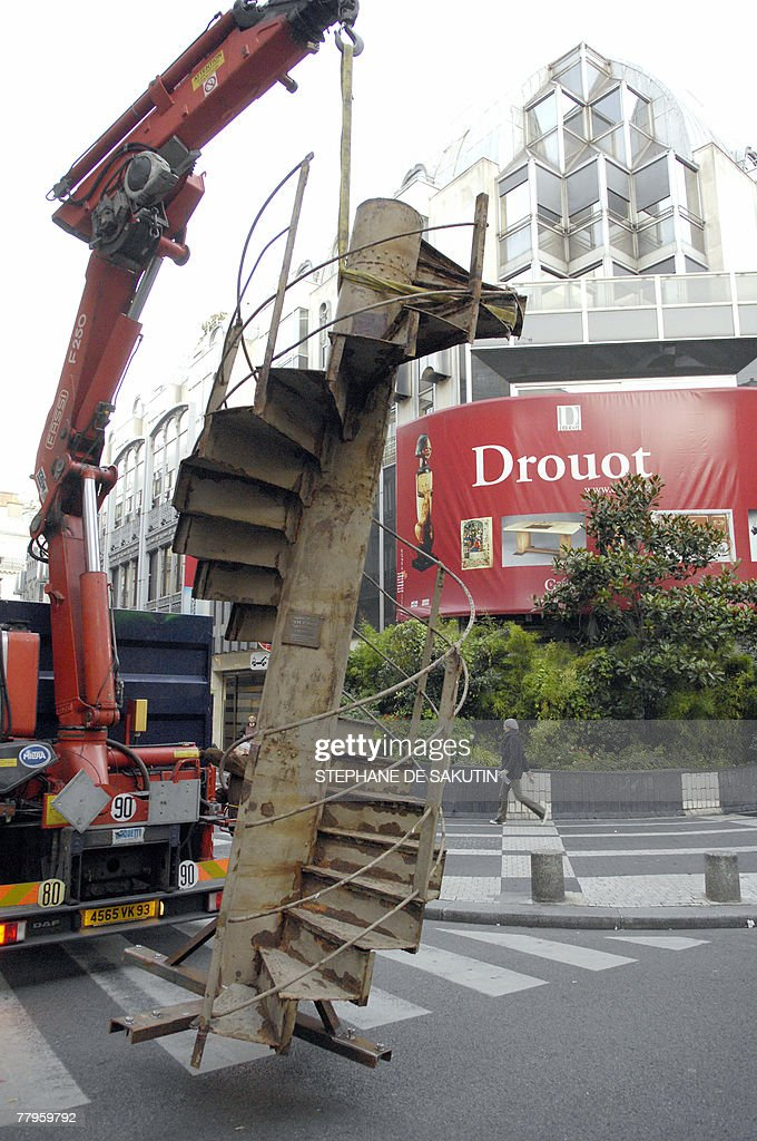 A section of the Eiffel Tower's stairs is lifted to be displayed, 17 November 2007 in front of the Drouot auction house in Paris, during the installation of the structure. The Eiffel section will be auctioned 19 November 2007 for an estimation of 15.000-20.000 euros. AFP PHOTO STEPHANE DE SAKUTIN