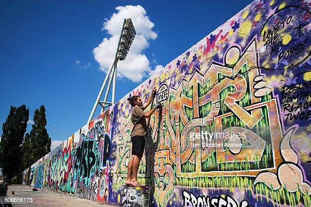 A section of the former Berlin Wall at Mauerpark which translates to Wall Park because of its proximity to the Death Strip Today the wall is a...