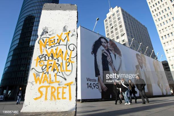 A section of the former Berlin Wall with the graffiti reading 'Next Wall To Fall Wall Street' stands on December 9 2011 in Berlin Germany Activists...