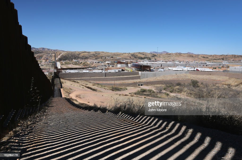 A section of the recently constructed fence at the U.S.-Mexico border stretches into the distance on February 26, 2013 in Nogales, Arizona. The newest generation of fencing allows Border Patrol agents to see through the fence and is harder to scale from the Mexican side.