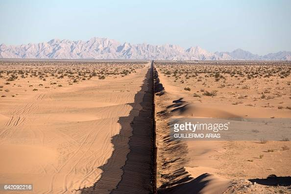 TOPSHOT A section of the US/Mexico border fence is seen at San Luis Rio Colorado Sonora state on February 15 2017 in northwestern Mexico this image...