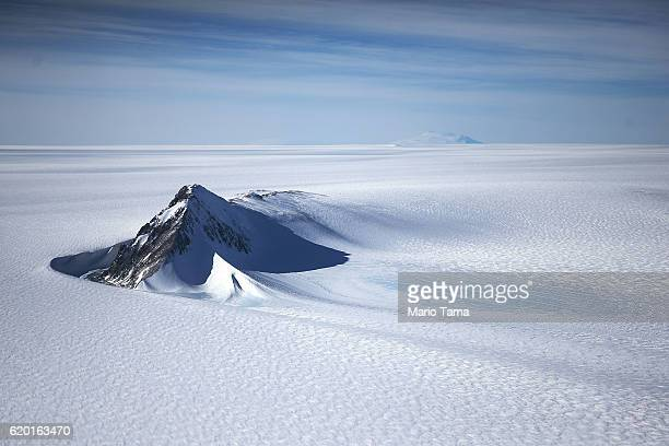 A section of the West Antarctic Ice Sheet with mountains is viewed from a window of a NASA Operation IceBridge airplane on October 28 2016 inflight...