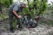 Section Ranger Rob talks to one of the suspected rhino poachers on November 7 2014 at the Kruger National Park South Africa The suspected rhino...