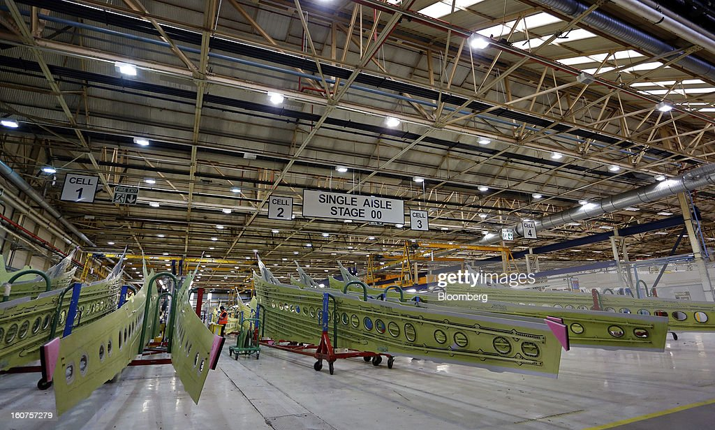 Sections of Airbus A320 single-aisle passenger aircraft wings sit stacked ahead of assembly on the production line at the company's factory in Broughton, U.K., on Monday, Feb. 4, 2013. Airbus SAS won a $9 billion order from Steven Udvar-Hazy's Air Lease Corp. that includes 25 A350 wide-body jets, a competitor to Boeing Co.'s grounded 787 Dreamliner. Photographer: Paul Thomas/Bloomberg via Getty Images