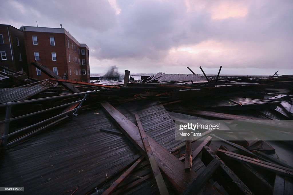 Sections of an old boardwalk are seen destroyed by flooding from Hurricane Sandy on October 30, 2012 in Atlantic City, New Jersey. The storm has claimed at least 33 lives in the United States, and has caused massive flooding across much of the Atlantic seaboard. US President Barack Obama has declared the situation a 'major disaster' for large areas of the US East Coast including New York City.