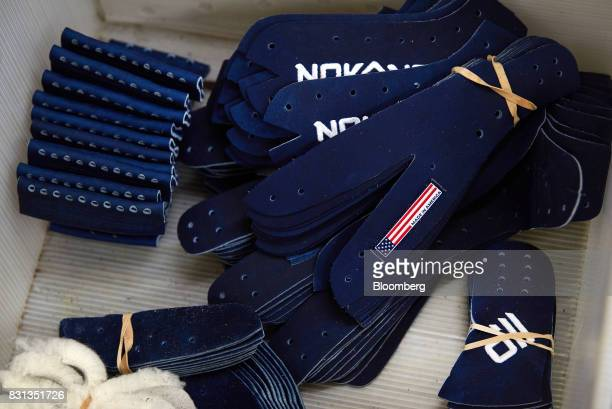 Sections of ball gloves sit in a bin at the Nokona manufacturing facility in Nocona Texas US on Thursday July 27 2017 Since the Great Depression...
