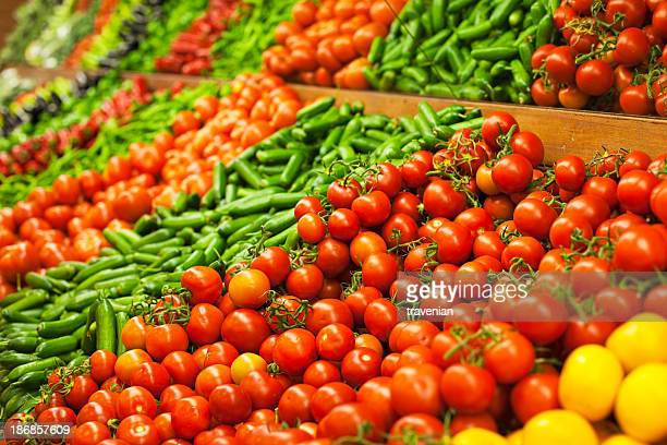 Sections of fresh organic vegetables in a market stall