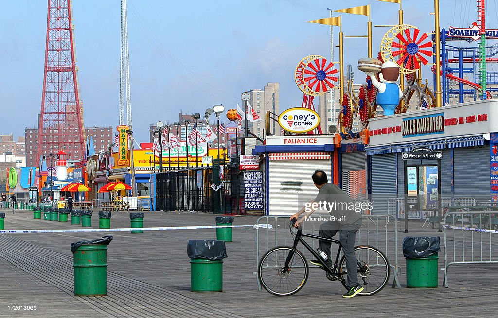 Sections of the boardwalk sit closed as the Astrotower is disassembled in Coney Island on July 4, 2013 in the Brooklyn borough of New York City. Officials decided to close Luna Park and sections of the boardwalk while workers take down the amusement tower which was seen precariously swaying two days ago.
