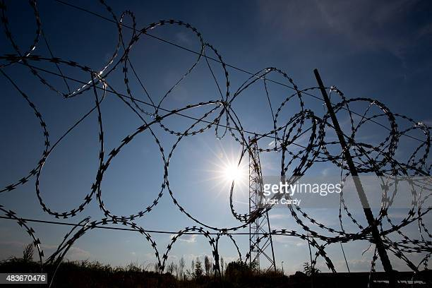 Sections of the border fence that has been recently erected along the Serbian Hungarian border is seen on August 11 2015 near Szeged Hungary...