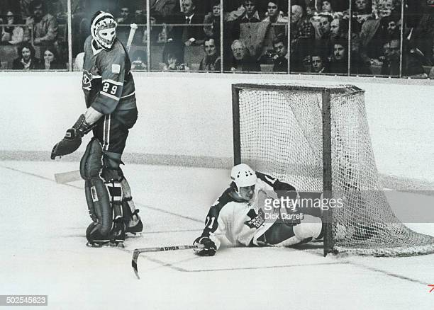 Secure Haven From The Storm Goalie Ken Dryden of Montreal Canadiens turns head in amazement as he finds Leafs' Inge Hammarstrom occupying vacated net...