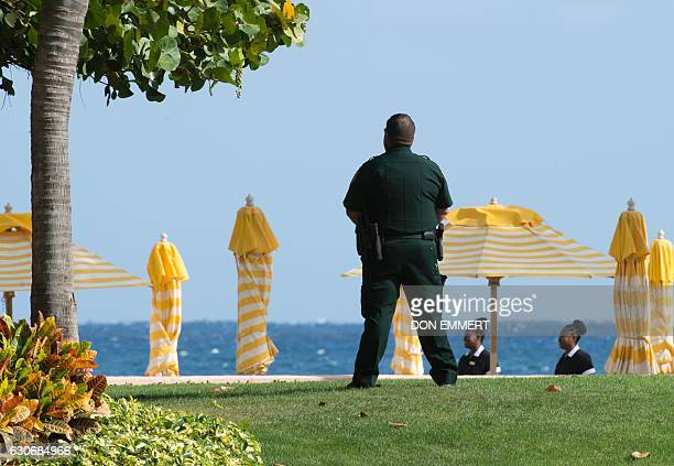 A security agent stands guard at the MaraLago Club where US Presidentelect Donald Trump is holding meetings December 30 in Palm Beach Florida / AFP /...