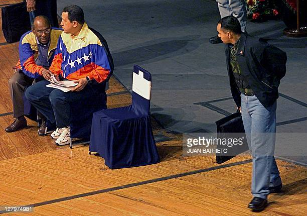 A security agent watches over Venezuelan President Hugo Chavez 29 January during a meeting with Venezuelan athletes in Caracas Vice foreign ministers...