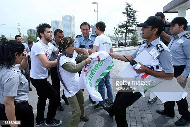 Security agents confront members of the environmental group Greenpeace during a protest organised by the NGO against Genetically Modified Organisms...