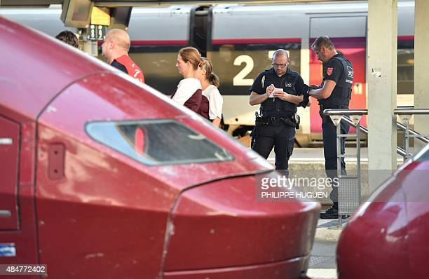 Security agents of French national railway operator SNCF stand next to Thalys trains at the main train station in Arras northern France on August 21...