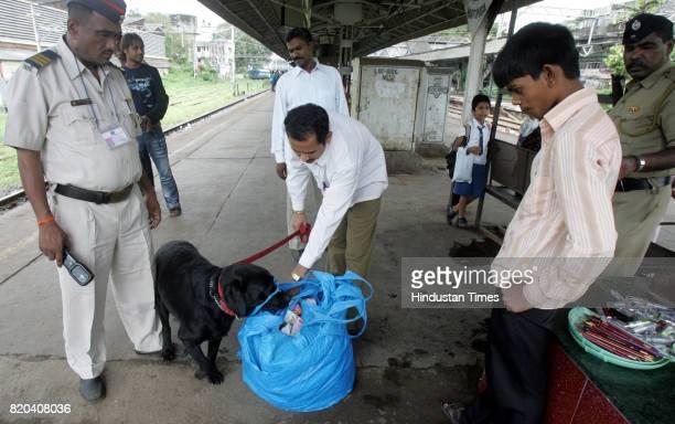 Security Alert Platform Railway Police with sniffer Dog Squad checking passengers bag at Matunga Railway station in Mumbai on Monday after Dehli...