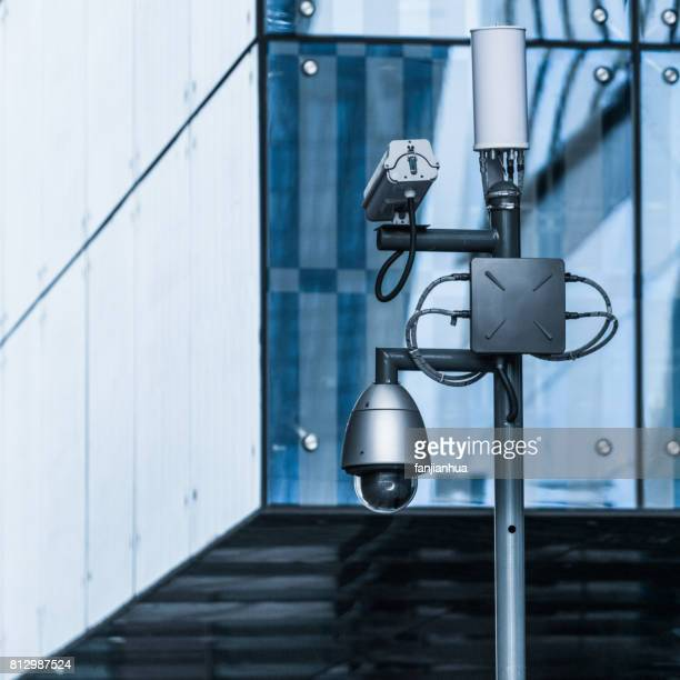 CCTV security camera against cityscape background