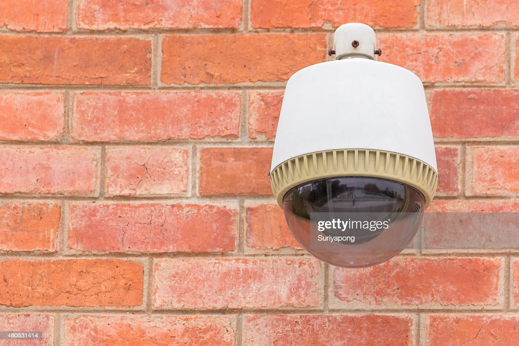 Security Camera CCTV On The Brick Wall. : Stock Photo
