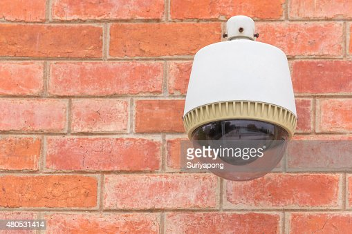 Security Camera CCTV On The Brick Wall. : Stockfoto
