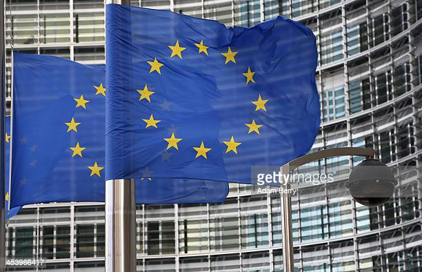 A security camera hangs next to the flag of the European Union outside the Berlaymont building of the European Commission on December 6 2013 in...