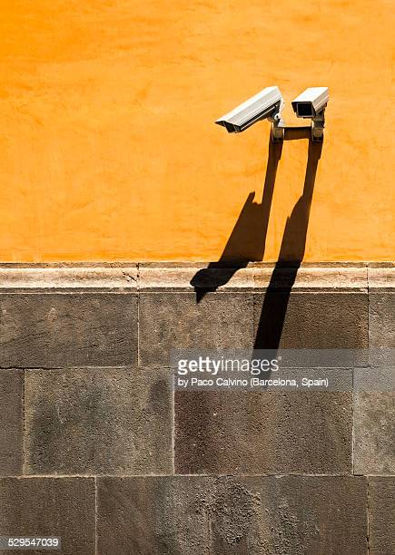 Security camera on colorful wall