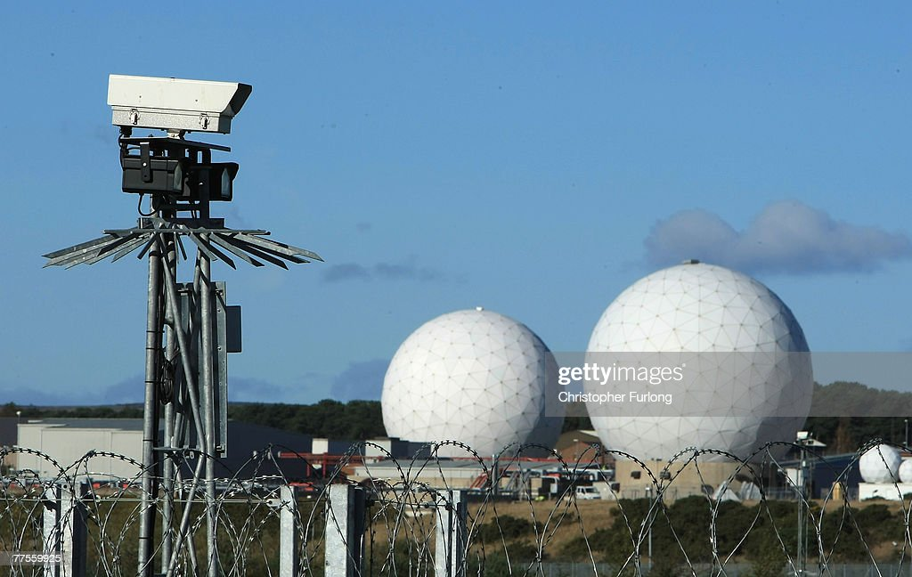 A security camera overlooks the radar domes of RAF Menwith Hill in north Yorkshire dominate the skyline on 30 October, 2007, Harrogate, England. The base is reported to be the biggest spy base in the world. Britain recently agreed to a United States request for the RAF Menwith Hill monitoring station, also known as the 13th field station of the US national security agency. in North Yorkshire to be used as part of its missile defence system, Dubbed 'Star War Bases' by anti-war and CND campaigners. The base houses British and United States personnel.