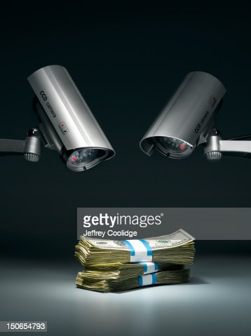 Security Cameras and Money : Stock Photo