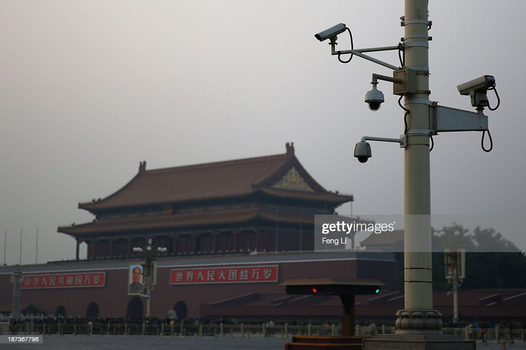 Security cameras are seen in front of the Tiananmen Gate on November 8, 2013 in Beijing, China. The Communist Party of China (CPC) will convene the Third Plenary Session of the 18th CPC Central Committee from November 9 to 12 to discuss comprehensively deepening reforms.