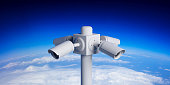 Security Cameras CCTV system. Surveillance cams on pole on blue sky, curvature earth background. 3d illustration