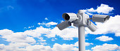 Security Cameras CCTV system. Surveillance cams on pole on blue sky background, banner, copy space. 3d illustration