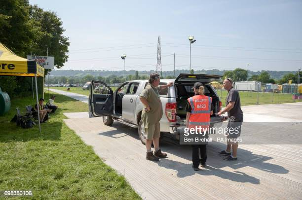 Security check the inside of vehicles as they access the site as preparations for the upcoming Glastonbury Festival at Worthy Farm in Pilton Somerset...