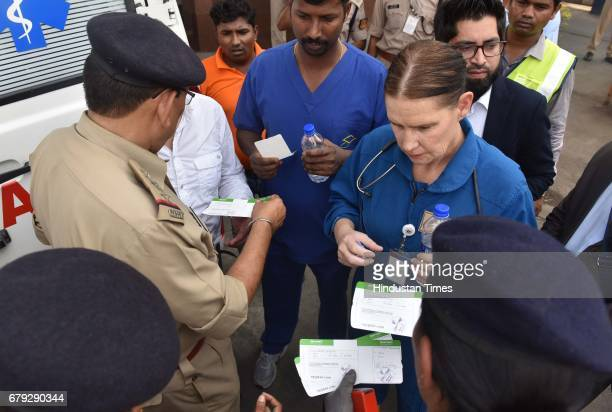 Security checking of the medical staff of Eman Ahmed near the ambulance which carries Eman Ahmed to the airport at Cargo Andheri on May 4 2017 in...