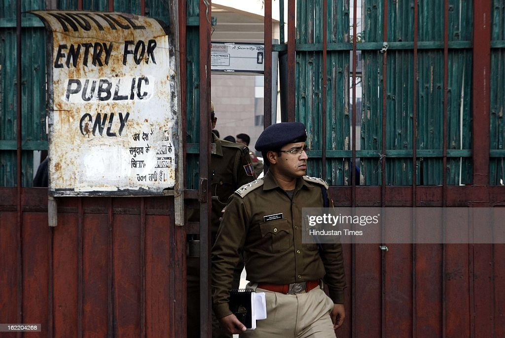 Security closed the entry gate to Rohini court after the shootout inside the premises on February 20, 2013 in New Delhi, India. Naveen an under trial in a murder case was shot twice in chest by the two members of rival gang. One of attackers has been arrested by the Police.