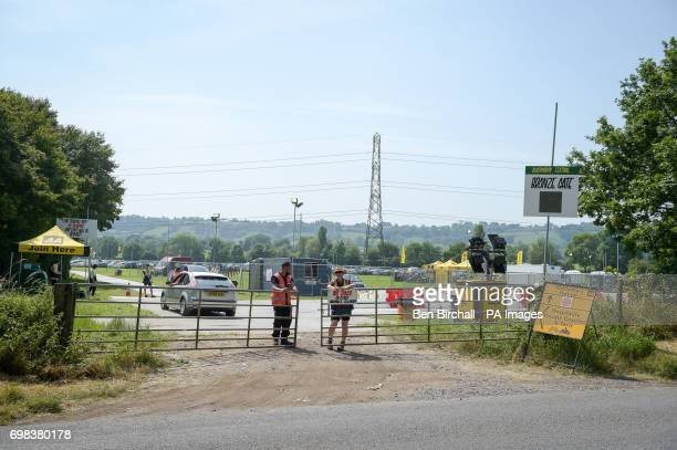 Security control gated access to the site as preparations for the upcoming Glastonbury Festival at Worthy Farm in Pilton Somerset continues