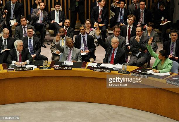 Security Council members Mark Lyall Grant permanent United Nations representative of the United Kingdom and US ambassador to the UN Susan Rice vote...