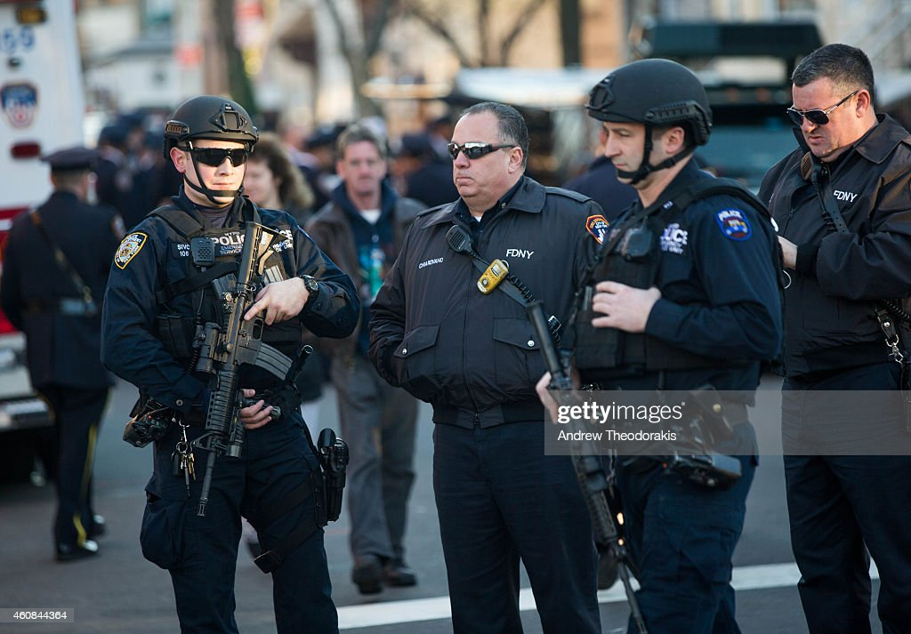 A security detail stands watch at the wake of New York City police officer Rafael Ramos at Christ Tabernacle Church on December 26 2014 in the...