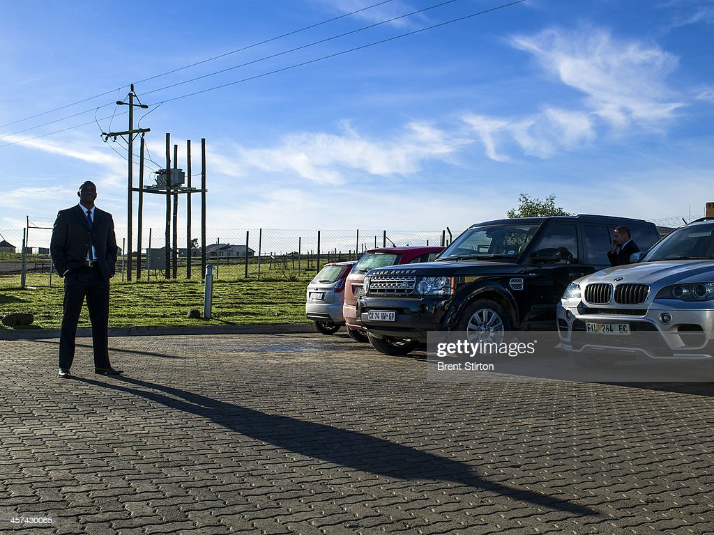 Security details for VIP's wait in the early morning to drive to the funeral of Nelson Mandela, Qunu, South Africa, 14 December 2014. An icon of democracy, Mandela was buried at his family home in Qunu after passing away on the 5th December 2013.
