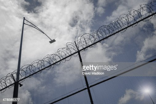 Security fence with razor wire and lights