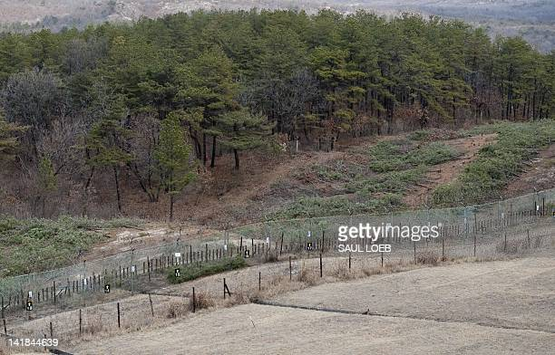 Security fences are pictured looking out towards North Korea from the South's Observation Post Ouellette in the Joint Security Area of the...