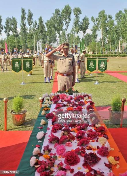 A security force officer salutes as he pays tribute to slain paramilitary Central Reserve Police Force SubInspector Sahab Shukla during the wreath...