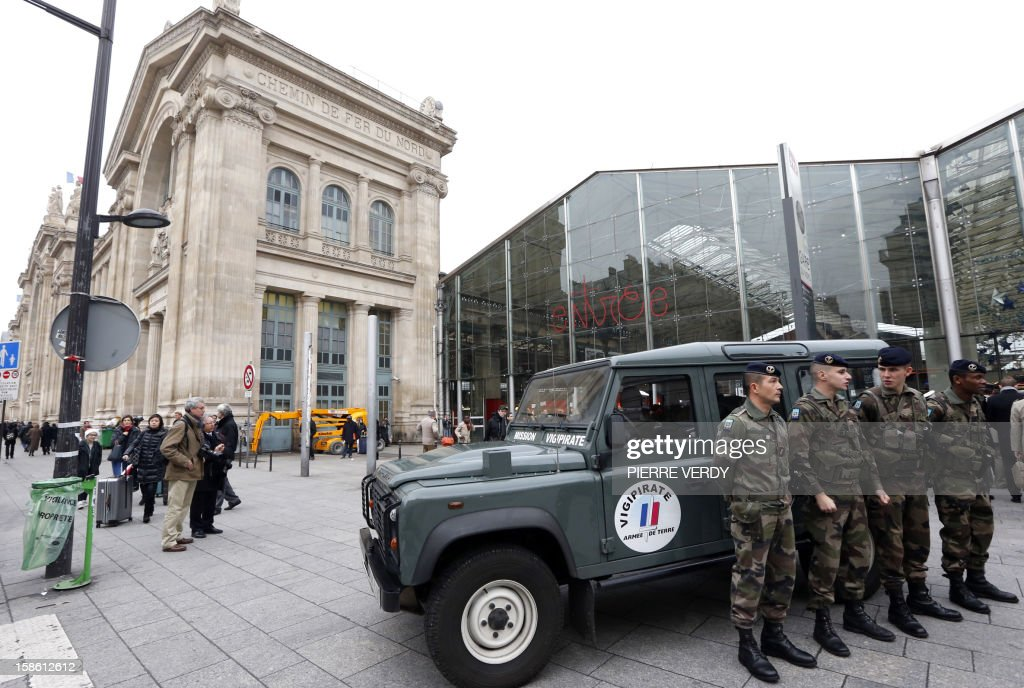 Security forces are deployed on December 21, 2012 at Gare du Nord railway station in Paris as France's national security alert system 'Plan Vigipirate' is reinforced for the Christmas holidays .