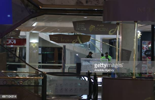 Security forces are seen at the Andino shopping mall in Bogota Colombia Saturday June 17 2017 At least three women were killed and nine people...