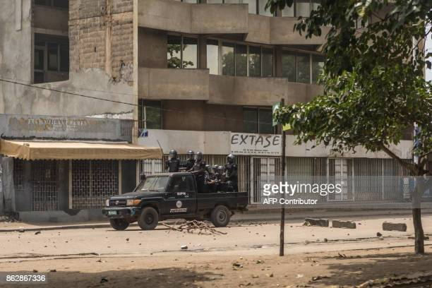 Security forces are seen during clashes with protesters as part of an antigovernment protest in Lome on October 18 2017 Protesters erected makeshift...