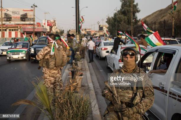 Security forces are seen on the streets as people celebrate taking part in the Kurdistan independece vote on September 25 2017 in Kirkuk Iraq Despite...