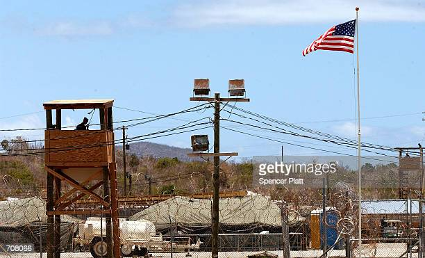 S security forces guard Camp XRay April 17 2002 in Guantanamo Bay Cuba Nearly 300 detainees from 33 different countries have been brought to Camp...