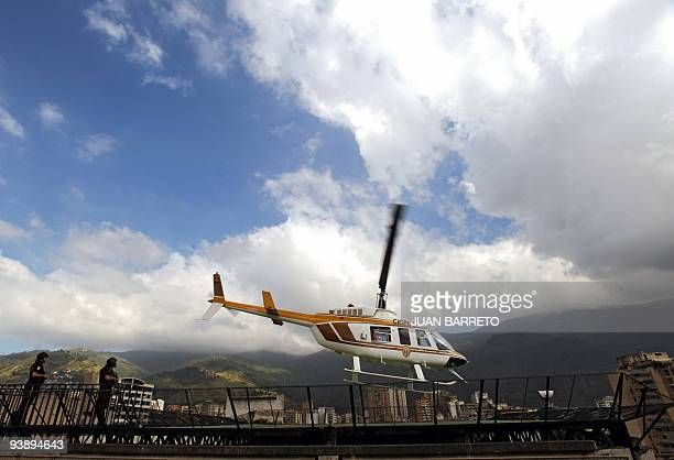 Security forces guard the heliport of the Board of Scientific Penitentiary and Criminal Investigations after the departure of the helicopter...