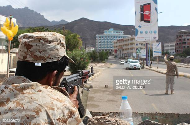 Security forces loyal to Yemen's President man a checkpoint in the southern city of Aden on January 18 a day after a suicide bombing targeted Aden's...