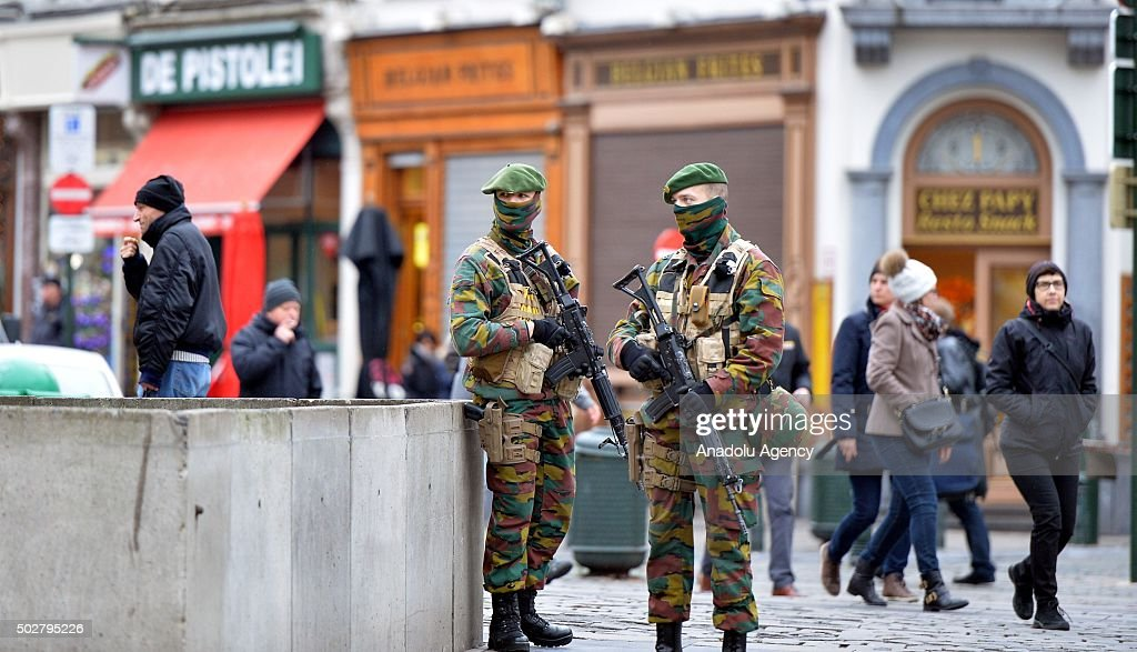 Security forces of Belgium stand guard as two people arrested on suspicion of terrorism in Brussels, Belgium on December 29, 2015.