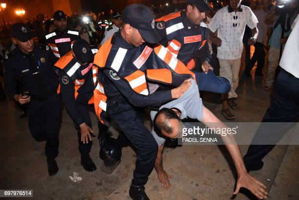 Security forces seize a demonstrator in Rabat on June 20 2017 during a protest in support of the grassroots movement for the neglected Rif region The...